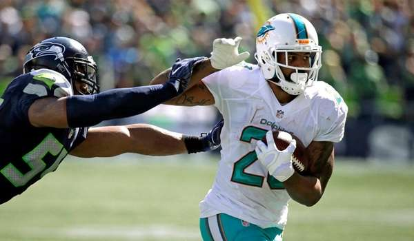 Miami Dolphins running back Arian Foster tries to