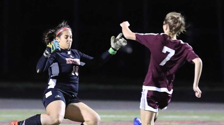 Bay Shore's Lexi Grassia beats Newfield goalie Alexis