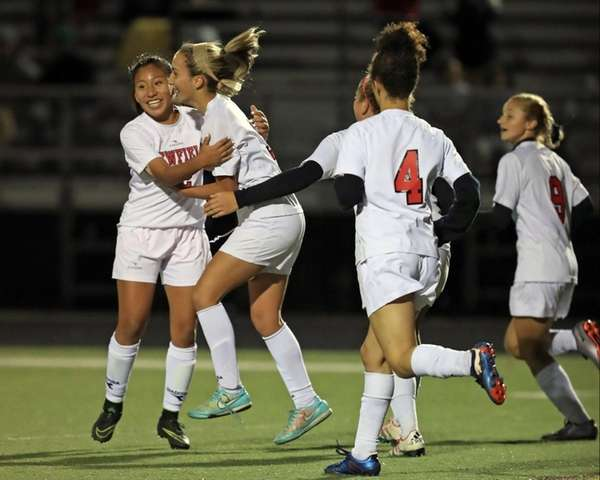 Newfield teammates congratulate Sierra Rosario, second from left,