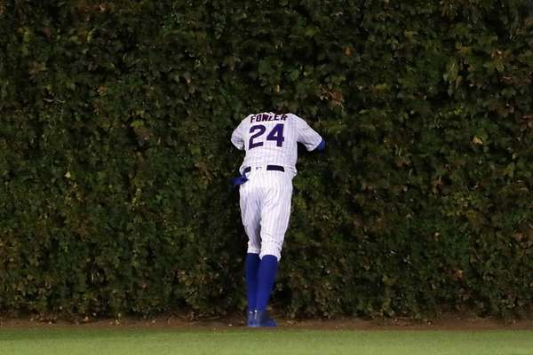 Dexter Fowler of the Chicago Cubs stands at