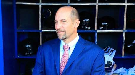 Former Atlanta Braves pitcher John Smoltz stands in