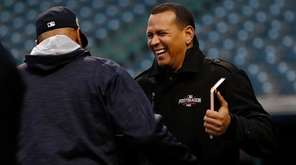 Cleveland Indians coach Sandy Alomar Jr. (L) and