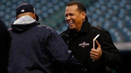 Cleveland Indians coach Sandy Alomar Jr. (L) and