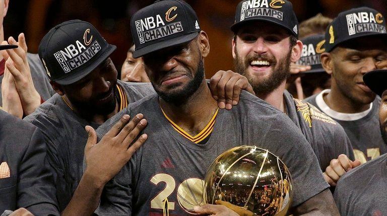 Cleveland Cavaliers forward LeBron James, center, celebrates with