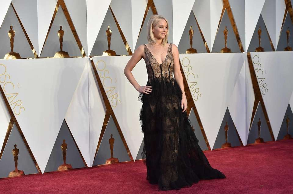 Jennifer Lawrence arrives at the Oscars on Sunday,