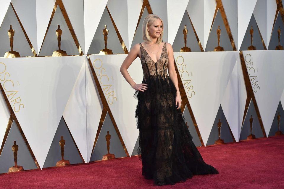 Jennifer Lawrence arrives at the Oscars on Sunday,