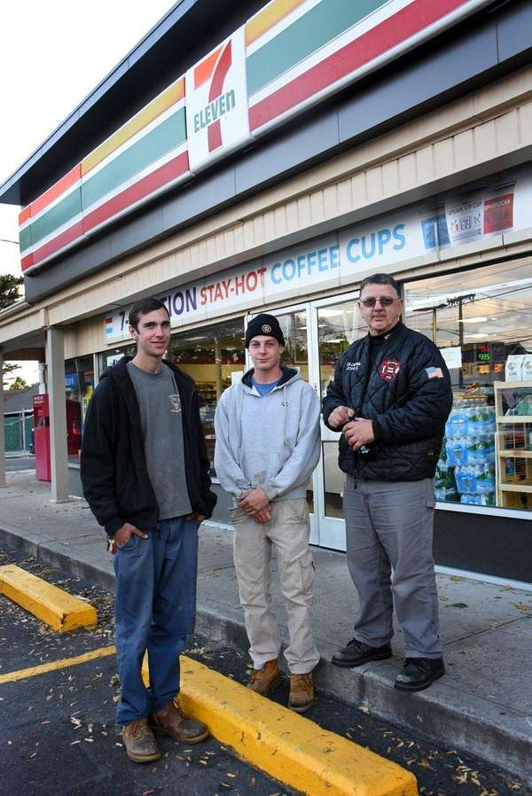Off-duty Bellmore firefighters Matthew Smith, left, and John