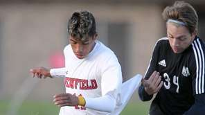 Newfield's Olvin Yanes (11) brings the ball upfield