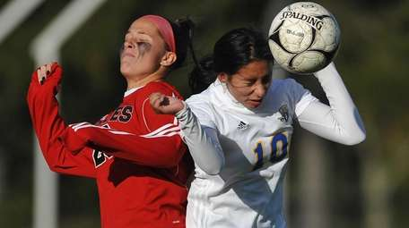 Melanie Navas of East Meadow, right, heads a
