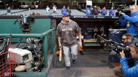 Chicago Cubs' Kyle Schwarber makes his way to