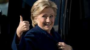 Democratic presidential candidate Hillary Clinton gives a thumbs