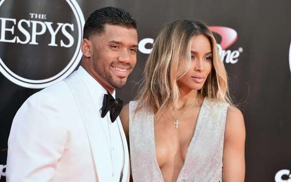 NFL football player Russell Wilson, left, and Ciara