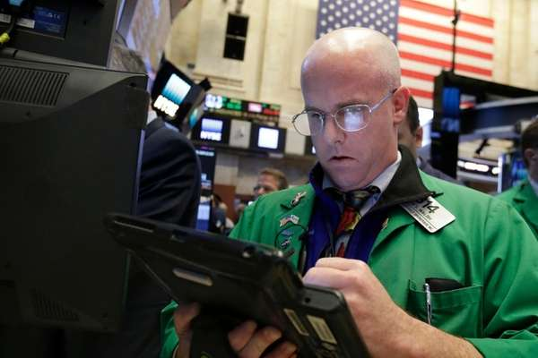 Trader Kevin Walsh works Monday, Oct. 24, 2016,