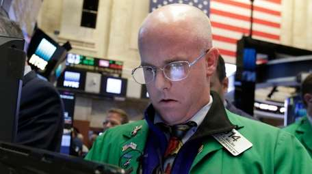 Trader Kevin Walsh works Monday, Oct. 24, 2016,