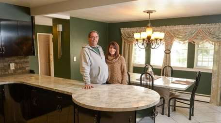 Doug and Maria Wuest in their Sayville house