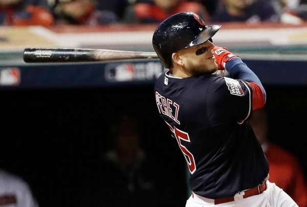 Cleveland Indians' Roberto Perez hits a three-run home