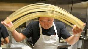 Chef Ken Chen makes hand-pulled noodles, a Northern