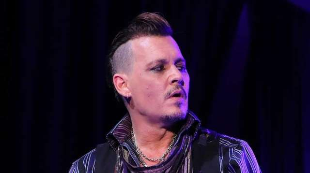 Johnny Depp performs with his band, The Hollywood