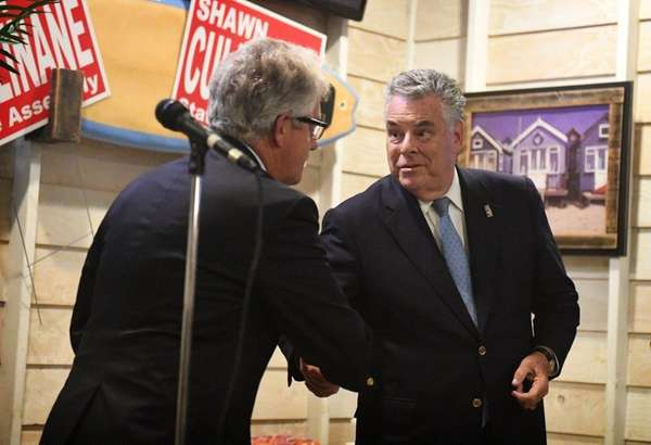 Rep. Peter King, right, shakes hands with State