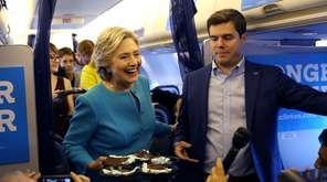 Hillary Clinton delivers birthday cake to reporters on