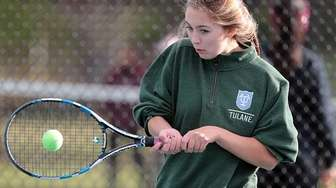 Friends' Grace Riviezzo with the backhand return during