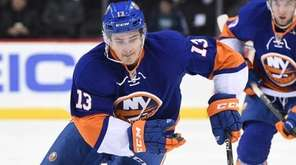 New York Islanders' center Mathew Barzal skates with