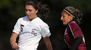 Garden City's Katherine Galzerano, left, passes upfield as