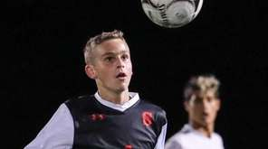 Matt Leav of Syosset controls the ball in