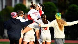 Sacred Heart girls soccer team celebrate their win