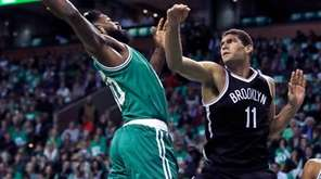 Boston Celtics forward Amir Johnson, left, grabs a