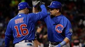 Chicago Cubs' Kyle Schwarber is congratulated by first
