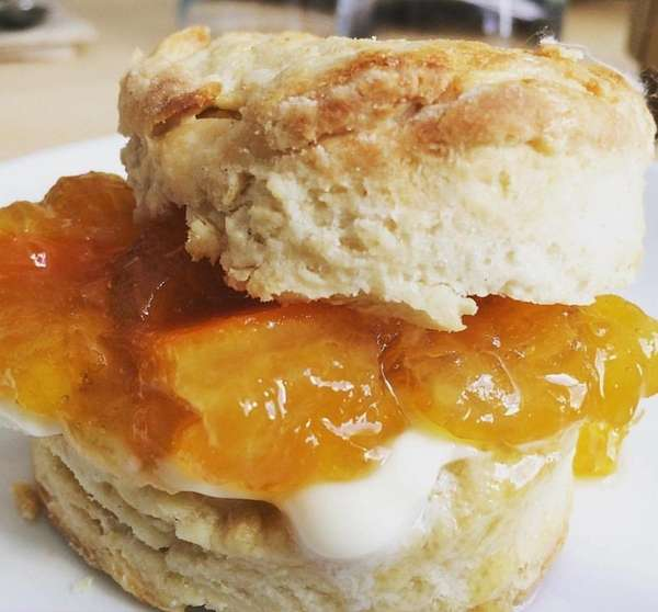Biscuits slathered with house-made honey butter or orange