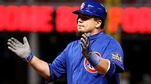Kyle Schwarber of the Chicago Cubs reacts after