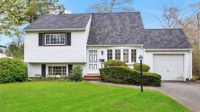This Bellport split-level house, listed for $275,000 in