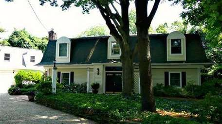 This Bellport Colonial, listed for $1.35 million in