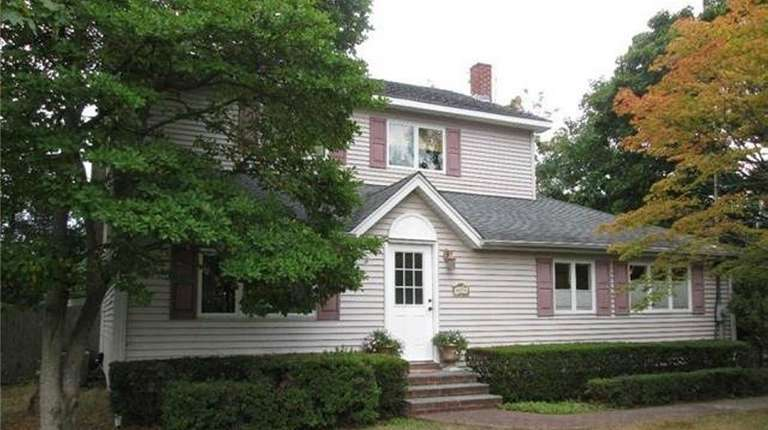 This Bellport Colonial, on the market in October