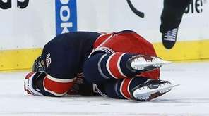 Dan Girardi of the New York Rangers lays