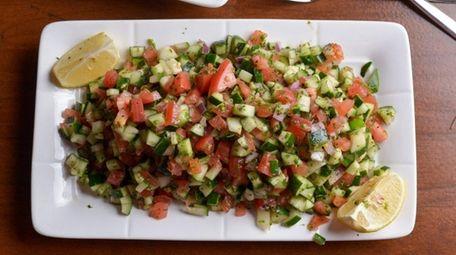 Shirazi salad fills the plate with lemon-dressed cucumber,
