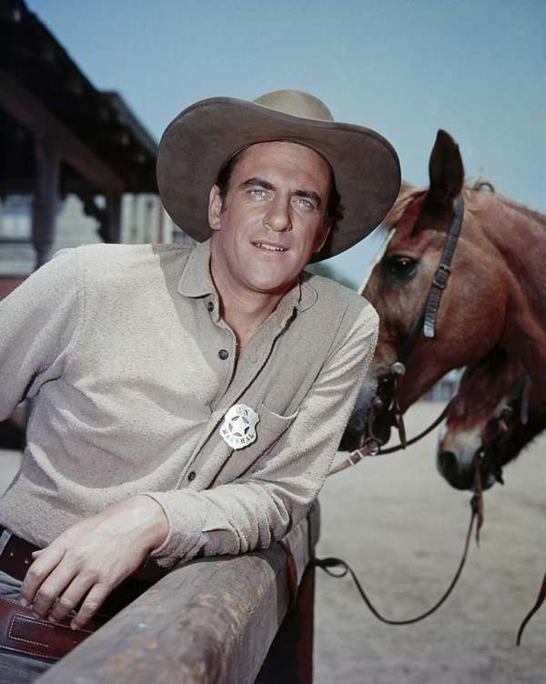 Actor James Arness is shown as Marshal Matt