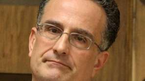 Oyster Bay Town Attorney Leonard Genova is a