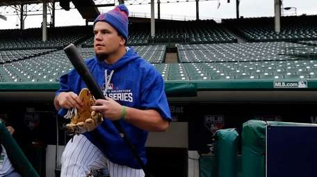 Chicago Cubs' Kyle Schwarber walks out to the