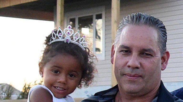 Benjamin Lopez, with grandaughter Navaeh McCall, 3, is