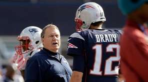 New England Patriots head coach Bill Belichick, left,