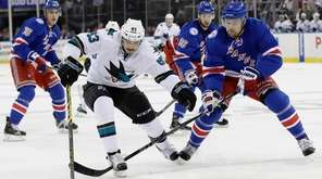 San Jose Sharks' Matt Nieto fights for control