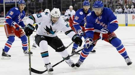 San Jose Sharks' Matt Nieto fights for control