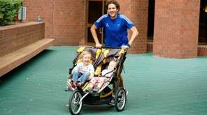 Chris Solarz pushes a double stroller with his