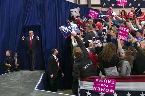 Republican presidential nominee Donald Trump greets supporters at