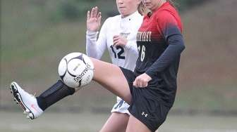 Sachem East's Morgan DeBenedictis (16) plays the ball