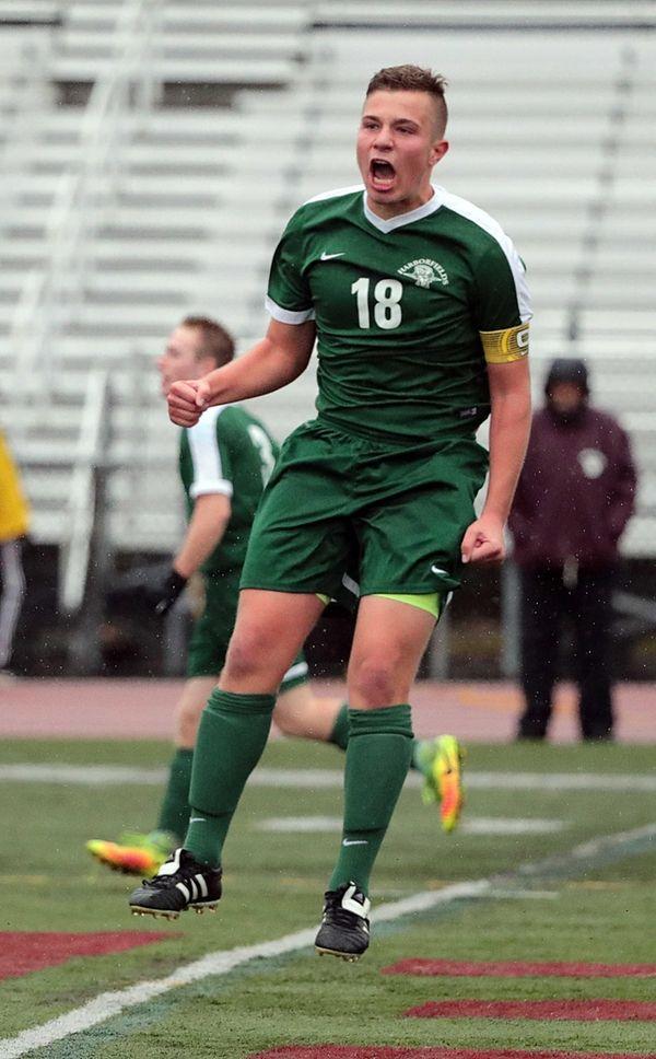 Harborfields' Mason Mee (18) celebrates after scoring during