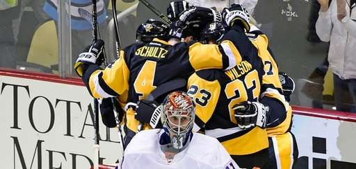 The Pittsburgh Penguins celebrate the goal as New